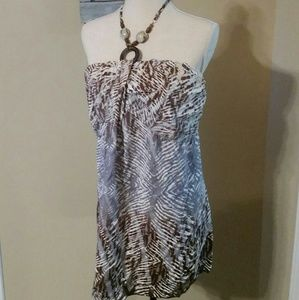 New Catos halter top. Has beads at neck.